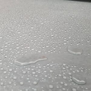 grey flat roof with water droplets