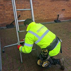 roofer checking safety of ladder